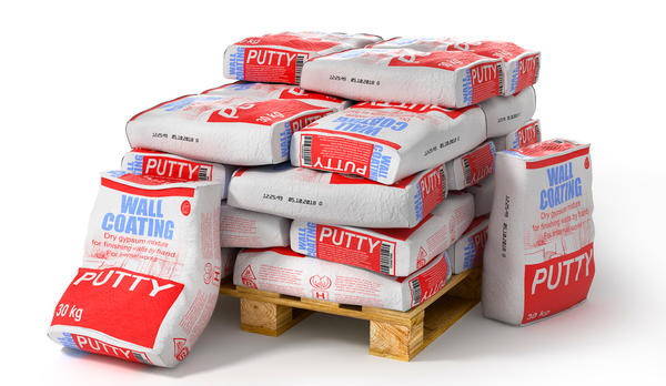 Putty bags stack on wooden pallet. Paper sacks isolated on white background. 3d illustration