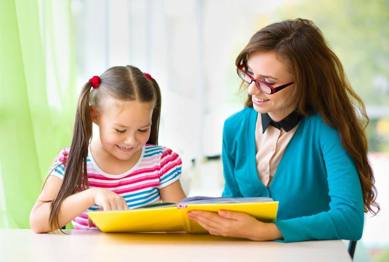 bigstock-mother-is-reading-book-with-he-52663180